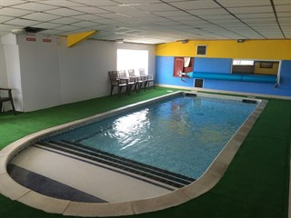 swimming facilities at Millers Cottage Caravan Park, Towyn