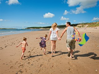Treaddur Bay is a short drive from Hendy Caravan Park with golden beaches