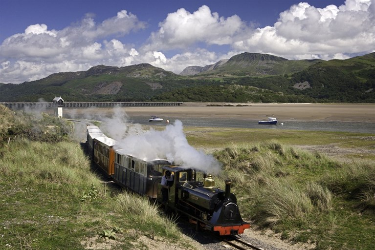 Train with Barmouth Bridge in background